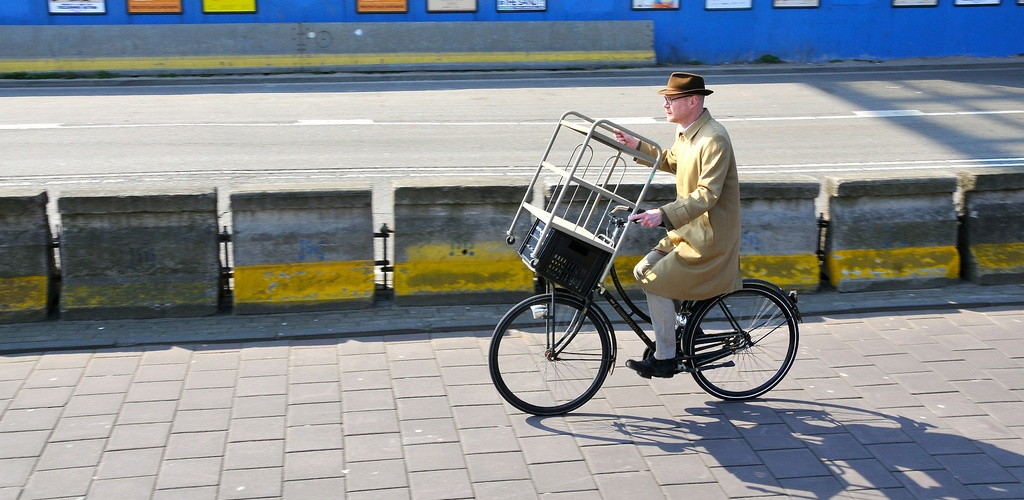 cycling in amsterdam: cyclist type amsterdam transporting everything